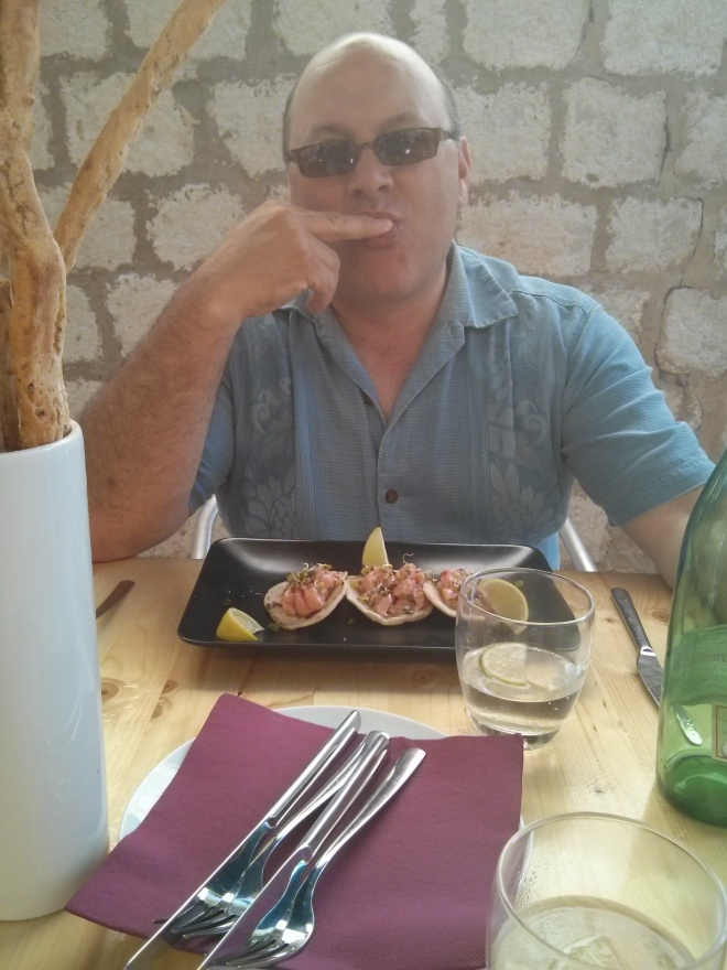 Jean eating salmon tacos
