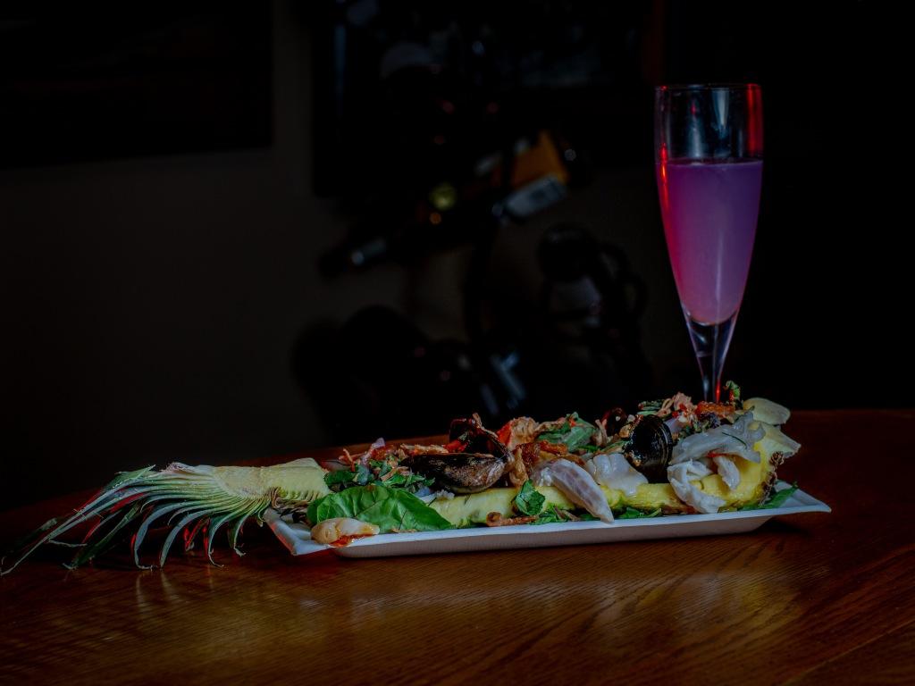 Marinated seafood on pineapple