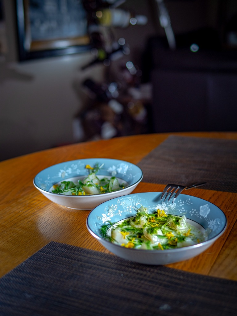 Sea scallops in buttermilk sauce with herbs and lime dust